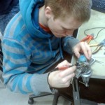 Karl is soldering a motor control PCB for the Nasty robot